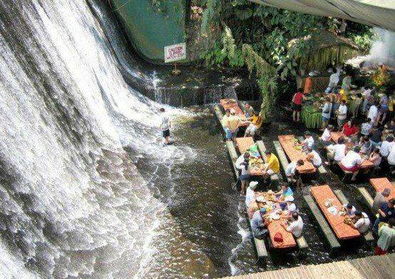 A restaurant where you eat barefoot in water from a waterfall - Villa Escudero is located in Quezon Province, Philippines.