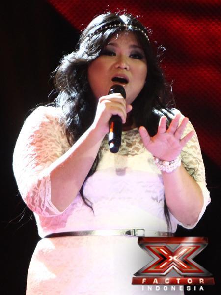Siapa Yang Tidak Kenal Dia?? Kontestan X-Factor Satu Ini! Pada Gala Show Ke-7! Dia Mendapat Peringkat SMS Tertinggi! Penyanyi Berbadan Gemuk Ini! Mempunyai Suara Yang Begitu Fantastic! Dia Membawakan Lagu PARADISE ! Serasa Berada Di SURGA