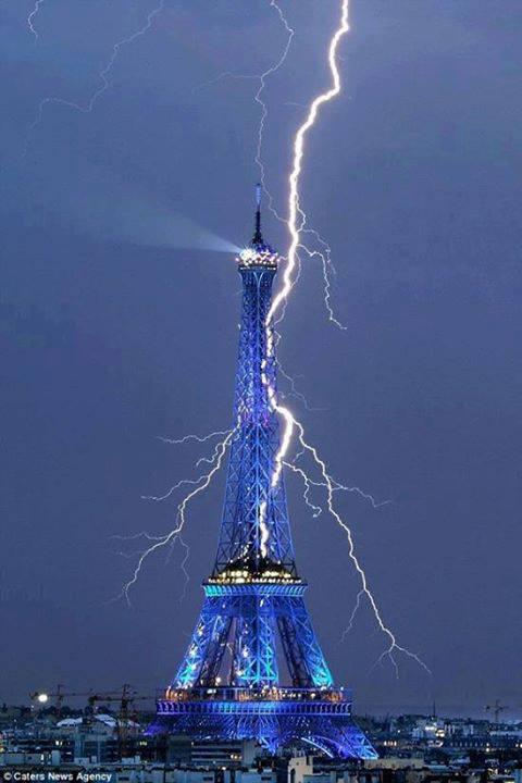 The Eiffel Tower getting struck by lightning.