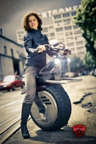 Cool! RYNO Motors single-wheeled electric scooter is self-balancing, has a turning radius of zero when stopped, and only takes up about as much space as a folding bycicle.