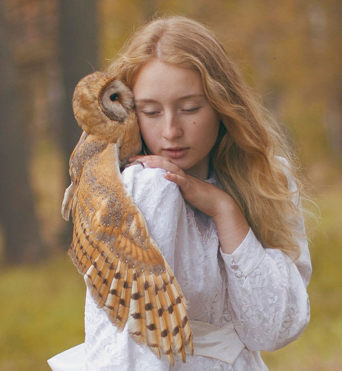 Katerina Plotnikova; white dress, gold owl and her hair,,, and a kiss.