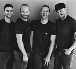"""Coldplay is a British alternative rock band, formed in London, United Kingdom in 1997. The band comprises vocalist and pianist Chris Martin, lead guitarist Jonny Buckland """" who met each other in September 1996 at Ramsay Hall (halls of residence"""