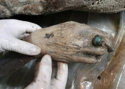 Mumi berumur 700 tahun ditemukan di China, jarinya memakai batu akik