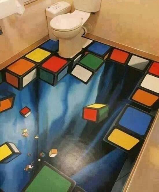 Walaupun hanya desain lukisan 3 Dimensi, pulsker pasti kaget ketika akan masuk kedalam toilet yang seolah-olah berlubang dan rubiknya berjatuhan.