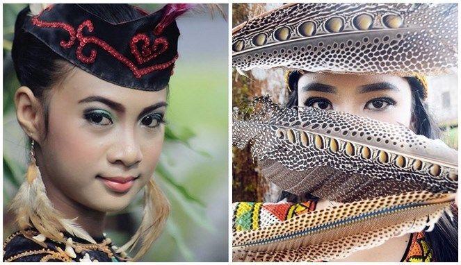 Dengan tatapan yang tajam membuktikan jika perempuan Suku Dayak memiliki mata yang indah.
