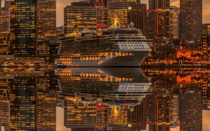 Kapal Pesiar yang seolah kembar dihiasi indahnya lampu-lampu dari gedung pencakar langit.