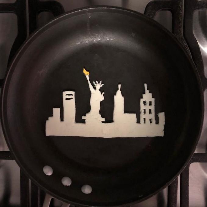 Siluet ikon Amerika dalam lukisan dari telur goreng.