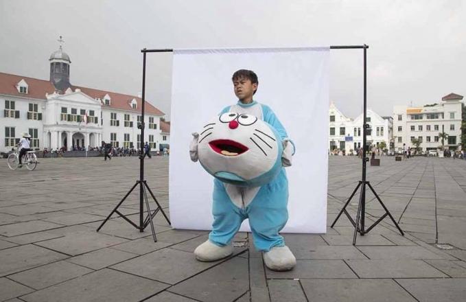 Pasti kepala Doraemonnya berat banget tuh?.