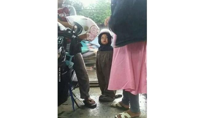 Jas hujan muslimah buat anak